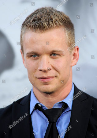 """Jesse Luken, a cast member in """"42,"""" poses at the Los Angeles premiere of the film at the TCL Chinese Theater on in Los Angeles"""