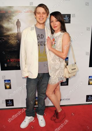 "Stock Picture of J. Michael Trautmann, left, and Alyssa Lobit arrive at the LA premiere of ""A Resurrection"" at the ArcLight Cinemas on in Los Angeles"