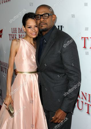 """Forest Whitaker, right, and Keisha Nash Whitaker arrive at the Los Angeles premiere of """"Lee Daniels' The Butler"""" at the Regal Cinemas L.A. Live Stadium 14 on"""