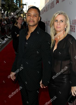 """Stock Picture of Cuba Gooding Jr., left, and Sara Kapfer arrive at the Los Angeles premiere of """"Lee Daniels' The Butler"""" at the Regal Cinemas L.A. Live Stadium 14 on"""