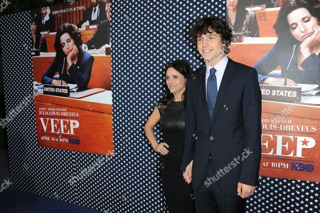 """Julia Louis-Dreyfus, left, and Charles Hall arrive at the LA premiere of the 2nd season of """"VEEP"""" at Paramount Studios on in Los Angeles"""