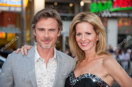 """Stock Image of Sam Trammell, left, and Missy Yager arrive at the Los Angeles premiere of the 7th and final season of """"True Blood"""" at the TCL Chinese Theatre on"""
