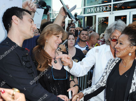 """Stock Photo of Keaton Simons, from left, Eliza Garrett, Eric Roberts, and Wanda Sykes arrives at the LA premiere of """"The Hot Flashes"""" at the ArcLight Hollywood on in Los Angeles"""