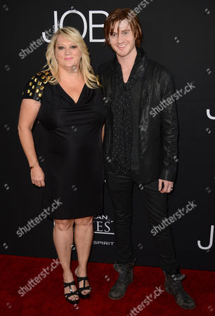 """Eddie Hassell and mother (right) arrive at the special screening of """"Jobs"""" at the Regal Cinemas L.A. Live, in Los Angeles"""
