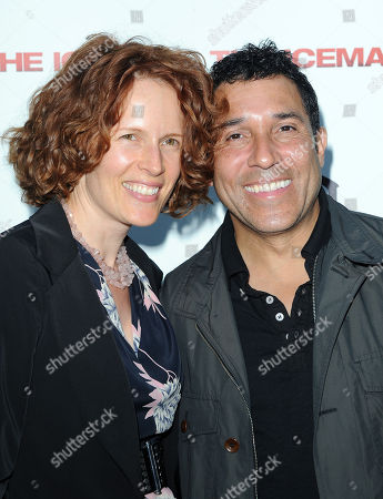 """Oscar Nunez, at right, and his wife, Ursula Whittaker, arrive at the LA Special Screening of """"The Iceman"""" at the ArcLight Hollywood Theater on in Hollywood, Calif"""