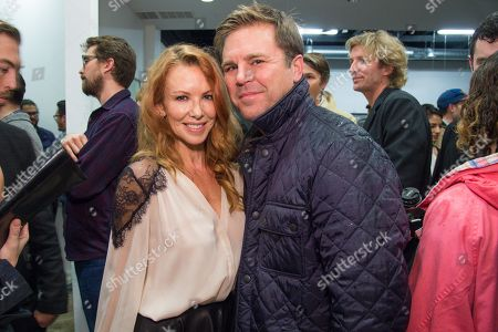 Stock Picture of Challen Cates, left and Aaron MacPherson attend the LAXART Opening at 7000 Santa Monica Blvd., in Los Angeles