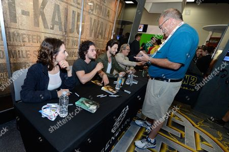 From left, actors Antje Traue, Kit Harington, Ben Barnes, Jeff Bridges and director Sergey Bodrov of 'Seventh Son' sign autographs for fans at the Legendary Entertainment booth at Comic-Con International 2013, on Saturday, July, 20, 2013 in San Diego