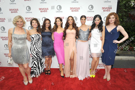 From left, Melinda Page Hamilton, Susan Lucci, Judy Reyes, Ana Ortiz, Dania Ramirez, Roselyn Sanchez, Edy Ganem and Rebecca Wisocky arrive at Lifetime's Devious Maids Premiere Party, on in Pacific Palisades, Calif