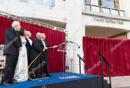 Pianist Emanuel Ax, from left, Lincoln Center chair Katherine Farley, New York Philharmonic chair Oscar Schafer, David Geffen and Lincoln Center president Jed Bernstein pull the rope at the Renaming Ceremony for David Geffen Hall, in New York