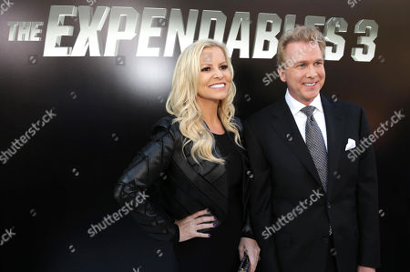 """Creighton Rothenberger, right, arrives at the Lionsgate Los Angeles premiere of """"The Expendables 3"""" at TCL Chinese Theatre, in Hollywood, Calif"""
