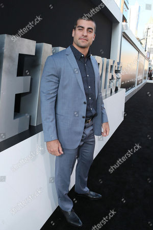 """Thomas Canestraro arrives at the Lionsgate Los Angeles premiere of """"The Expendables 3"""" at TCL Chinese Theatre, in Hollywood, Calif"""