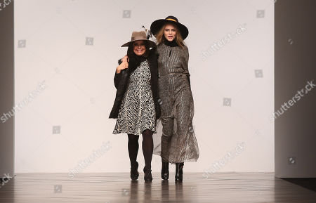 British model Cara Delevingne, right and Brazilian designer Daniella Helayel take the applause after the show by Issa during London Fashion Week, at Somerset House in central London