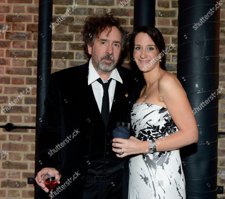 Tim Burton, Allison Abbate poses at London Film Festival Opening Gala Frankenweenie After Party at Tobacco Dock on in London