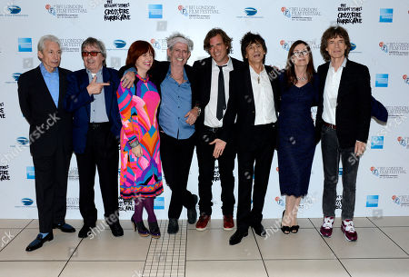 Charlie Watts, Bill Wyman, Claire Stewart, Keith Richards, Brett Morgan, Ronnie Wood, Victoria Pearman, Mick Jagger poses at London Film Festival American Express Gala The Rolling Stones - Crossfire Hurricane at Odeon West End on in London