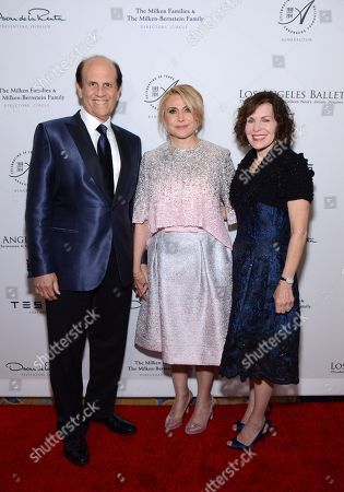 Michael Milken, left, Ghada Irani, center, and Lori Milken arrive at the Los Angeles Ballet Gala at the Beverly Wilshire Hotel, in Beverly Hills, Calif