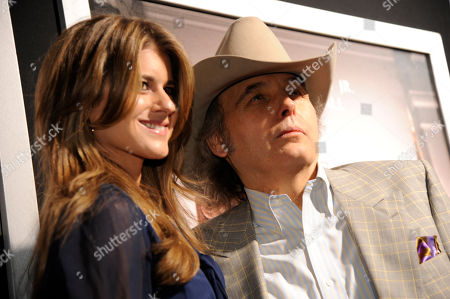 """Emily Joyce, left, and Dwight Yoakam arrive at the premiere of """"The Judge"""" at the Samuel Goldwyn Theater Academy of Motion Picture Arts & Sciences, in Beverly Hills, Calif"""