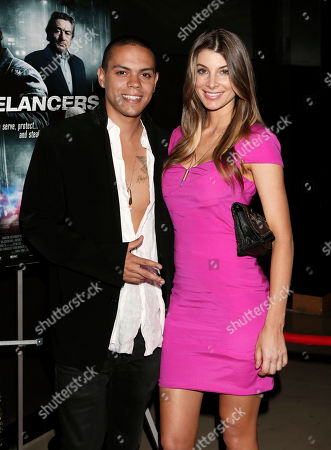 """Stock Photo of Evan Ross and Cora Skinner attend the Los Angeles Screening of """"Freelancers"""" at the Chinese Mann 6, in Los Angeles, Ca"""