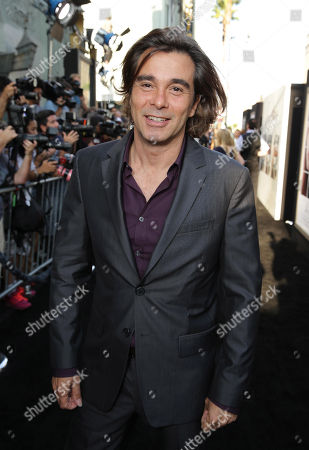 Composer Heitor Pereira seen at the Los Angeles World Premiere of New Line Cinema's and Metro-Goldwyn-Mayer Pictures' 'If I Stay' held at TCL Chinese Theatre, in Hollywood