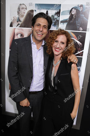Stock Image of President, Motion Picture Group for MGM Jonathan Glickman and Author Gayle Forman seen at the Los Angeles World Premiere of New Line Cinema's and Metro-Goldwyn-Mayer Pictures' 'If I Stay' held at TCL Chinese Theatre, in Hollywood