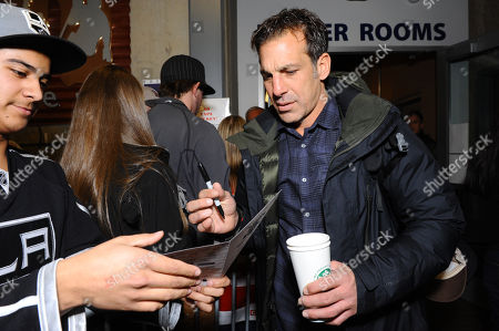 Chris Chelios, left, signs an autograph at Luc Robitaille's Celebrity Shoot Out benefitting Echoes of Hope, on in Park City, Utah