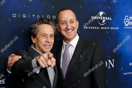 "Brian Grazier, left, and Jimmy Horowitz arrive at the March of Dimes ""Celebration of Babies: A Hollywood Luncheon"" at the Beverly Wilshire Hotel, in Beverly Hills, Calif"