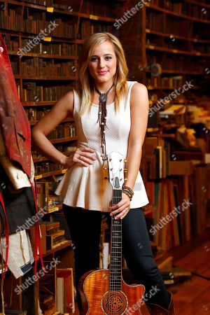 This photo shows 19-year-old country singer Mary Sarah posing at Hatch Show Print inside The Country Music Hall of Fame and Museum in Nashville, Tenn. On Tuesday, July 8, Mary Sarah released a new album called Bridges. It a duets cover album featuring country legends like Willie Nelson, Dolly Parton, Merle Haggard and the late Ray Price