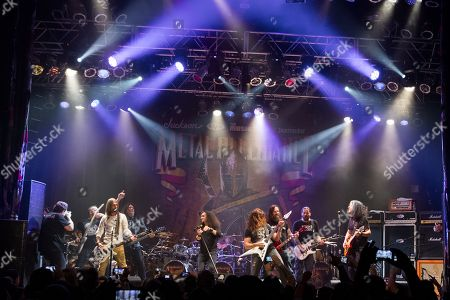 Stock Picture of From left, Mark Menghi, Rex Brown, of Pantera, Chuck Billy, of Testament, Mark Osegueda, of Death Angel, Chris Broderick, of Megadeth, Gary Holt, of Exodus, Andreas Kisser, of Sepultura, and Alex Skolnick, of Testament, perform on stage during the Metal Allegiance concert at the House of Blues, in Anaheim, Calif