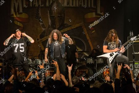 Steve Souza, of Exodus, Chuck Billy, of Testament, and Chris Broderick, of Megadeth, perform on stage during the Metal Allegiance concert at the House of Blues, in Anaheim, Calif