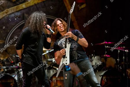 Mark Osegueda, of Death Angel, and Chris Broderick, of Megadeth, perform on stage during the Metal Allegiance concert at the House of Blues, in Anaheim, Calif