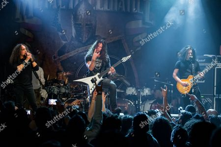 Mark Osegueda, of Death Angel, Chris Broderick, of Megadeth, and Alex Skolnick, of Testament, perform on stage during the Metal Allegiance concert at the House of Blues, in Anaheim, Calif