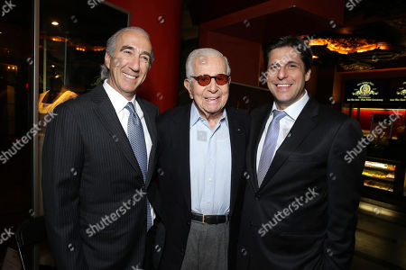 Stock Photo of PREMIUM RATES APPLY MGM's Chairman and CEO, Gary Barber, Walter Mirisch and President, Motion Picture Group for MGM Jonathan Glickman kick off MGM's 90th Anniversary with the company's iconic mascot Leo the Lion's Paw Print ceremony at the TCL Chinese Theater in Hollywood on