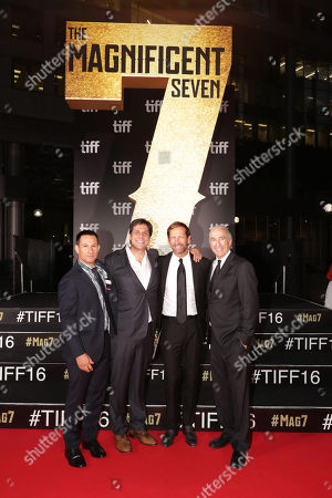 """Adam Rosenberg, MGM Executive Vice President of Production, Jonathan Glickman, President for Motion Picture Group, Anchorage Capital Group's Kevin Ulrich and Gary Barber, MGM Chairman and Chief Executive Officer, seen at MGM and Columbia Pictures' world premiere and opening night screening of """"The Magnificent Seven"""" at the 2016 Toronto International Film Festival, in Toronto, CAN"""