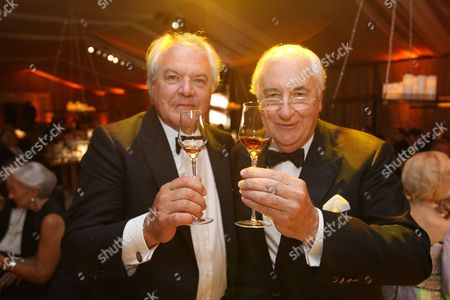 Chairman and CEO, Moet Hennessy Christophe Navarre and Master Blender for Hennessy Yann Filloiux are seen making a toast at the Moet Hennessy Celebration of the Hermione Voyage 2015 at George Washington's Mount Vernon, in Mount Vernon, Va