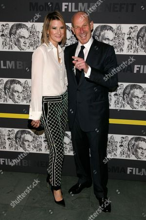Philanthropists Jon Tisch, right, and Lizzie Tisch, left, attend the Museum of Modern Art Film Benefit Tribute to Quentin Tarantino, at the Museum of Modern Art on in New York