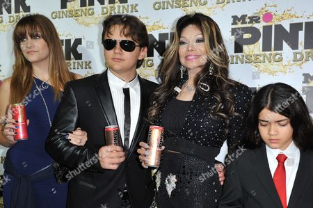 From left, Paris Jackson, Prince Michael Jackson, Latoya Jackson, and Blanket Jackson attend the Mr. Pink Ginseng launch party at the Beverly Wilshire hotel, in Beverly Hills, Calif
