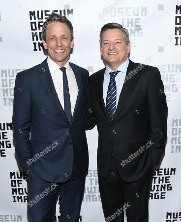 Honorees, talk show host Seth Meyers, left, and Netflix chief content officer Ted Sarandos pose with Museum of the Moving Image executive director Carl Goodman, center, at the Museum of the Moving Image's 2016 Industry Tribute at the St. Regis Hotel, in New York