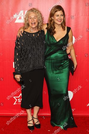 Singer Carole King, left, and daughter / singer Louise Goffin arrive at the MusiCares 2014 Person of the Year Tribute on in Los Angeles