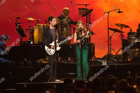 Singers Jakob Dylan, left, and Louise Goffin perform on stage at the MusiCares 2014 Person of the Year Tribute on in Los Angeles