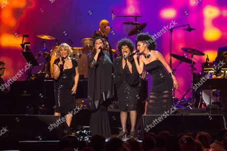 Singers Darlene Love, Merry Clayton, Judith Hill and Lisa Fischer perform on stage at the MusiCares 2014 Person of the Year Tribute on in Los Angeles