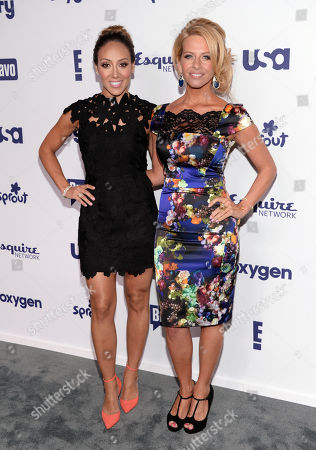 "Melissa Gorga, left, and Dina Manzo from ""The Real Housewives of New Jersey"" attend the NBCUniversal Cable Entertainment 2014 Upfront at the Javits Center, in New York"