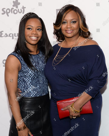 """Stock Image of Gabby Douglas, left, and Natalie Hawkins of """"Douglas Family Gold"""" attend the NBCUniversal Cable Entertainment 2015 Upfront at The Javits Center, in New York"""