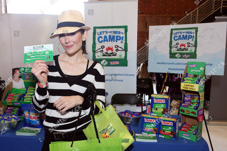 Actress Adrienne Wilkinson supports the #LetsGetHerToCamp campaign with Nestle Crunch Girl Scout Candy Bars at an Emmy Awards gift suite on in Los Angeles. To help send girls to Girl Scout camp visit NestleCrunch.com/LetsGetHerToCamp by August 31