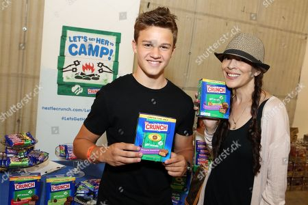 Actor Gavin MacIntosh, let, and figure skater Tai Babilonia support the #LetsGetHerToCamp campaign with Nestl? Crunch Girl Scout Candy Bars at a Teen Choice Awards gift suite on in Los Angeles. To help send girls to Girl Scout camp visit NestleCrunch.com/LetsGetHerToCamp by August 31