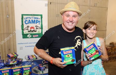 Stock Image of Actress Sinclair DuMont, right, supports the #LetsGetHerToCamp campaign with Nestle Crunch Girl Scout Candy Bars at a Teen Choice Awards gift suite on in Los Angeles. To help send girls to Girl Scout camp visit NestleCrunch.com/LetsGetHerToCamp by August 31
