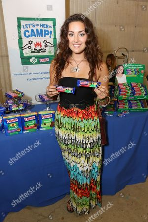 Actress Kaleina Cordova supports the #LetsGetHerToCamp campaign with Nestle Crunch Girl Scout Candy Bars at a Teen Choice Awards gift suite on in Los Angeles. To help send girls to Girl Scout camp visit NestleCrunch.com/LetsGetHerToCamp by August 31