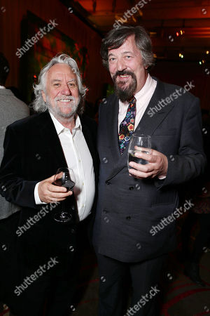 Stock Photo of Production designer Dan Hennah and Stephen Fry seen at New Line Cinema Premiere of 'The Hobbit: The Desolation of Smaug', held at the Dolby Theatre on in Los Angeles