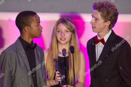 From left, actors Coy Stewart, Elise Luthman, and Joey Luthman present the award for Best Message during the No Bull Teen Video Awards at the Westin LAX Hotel on in Los Angeles