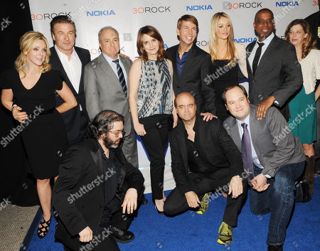 """The cast of '30 Rock' back row, from left, Jane Krakowski, Alec Baldwin, Lorne Michaels, Tina Fey, Jack McBrayer, Katrina Bowden,Keith Powell and front row, from left, Judah Friedlander, Scott Adsit and John Lutz attend the Nokia """"30 Rock"""" wrap party on in New York"""