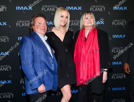 """Stock Picture of IMAX CEO Richard Gelfond, left, actress Jennifer Lawrence and director Toni Myers attend the premiere of """"A Beautiful Planet"""" at AMC Loews Lincoln Square, in New York"""