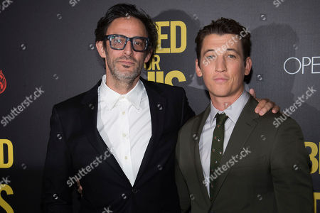 """Stock Image of Ben Younger and Miles Teller attend the premiere of """"Bleed For This"""" hosted by Open Road and Men's Fitness at AMC Loews Lincoln Square, in New York"""